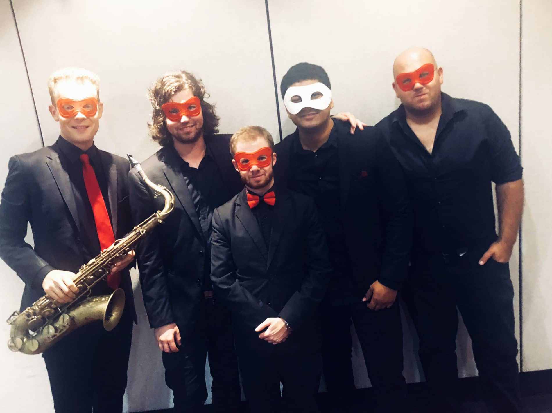 Redtie band in their masquerade getup for Brisbane